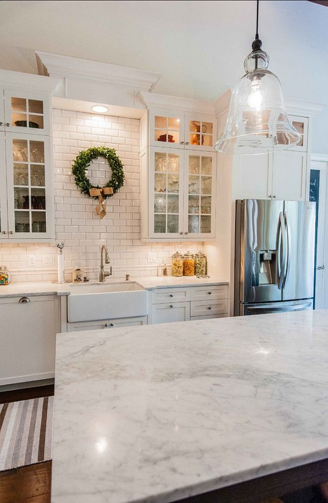 subway tile kitchen - marble counter. Cottage kitchen..needs a bit more color, but I like it.