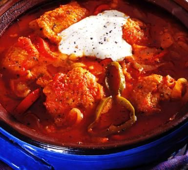 Hungarian Chicken Paprikash - This one-pot classic dish combines five key Hungarian ingredients -- onions, green peppers, tomatoes, paprika and sour cream. The recipe can be pulled together quickly, especially if the vegetables are prepped the night before. ( © Philip Wilkins / Getty Images)