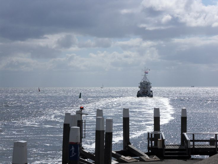 Ship leaving harbour Oudeschild (Waddenzee)