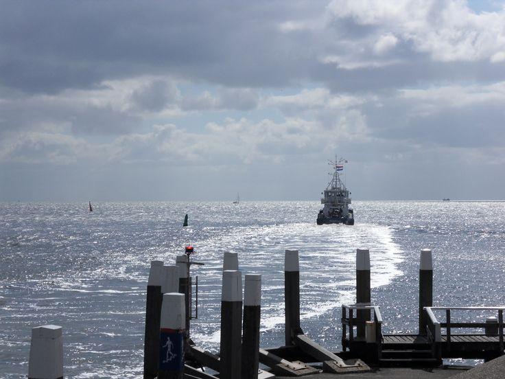 Ship leaving harbour Oudeschild (Waddenzee)