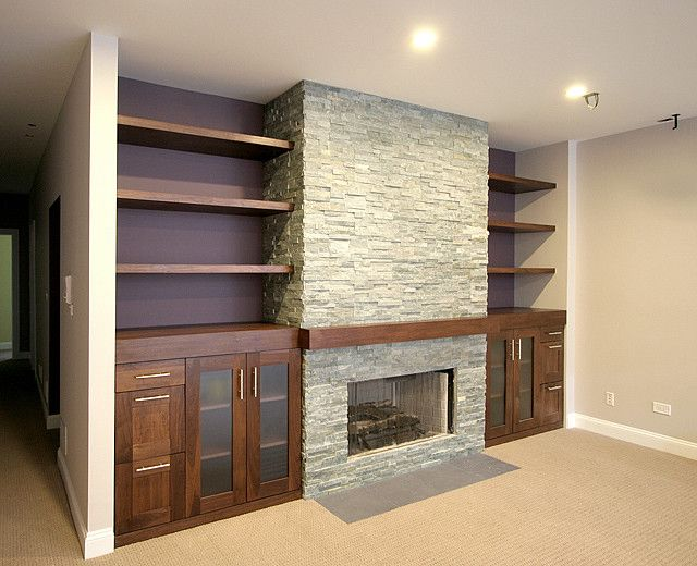 Love painted wall behind shelves, fireplace but with thicker mantle. Love the shaker cabinets.