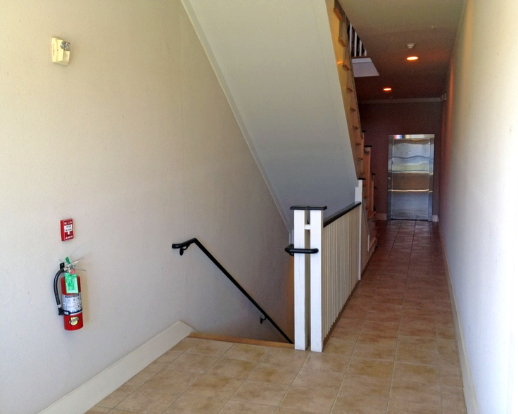 View of second floor foyer and elevator habersham for Elevator flooring options