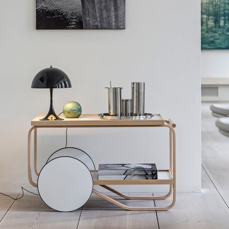 """Artek 901 Tea Trolley The 901 Tea Trolley by Artek is the simplest and most graceful tea trolley among the ones designed by Aalto. It is a perfect extra table for the living room and is of course excellent also for serving coffee or tea. The 901 Tea Trolley was designed by Alvar Aalto: """"The Tea Trolley utilizes a process for bending thick layers of birch into gracefully curved loops to create strong, light frames."""""""
