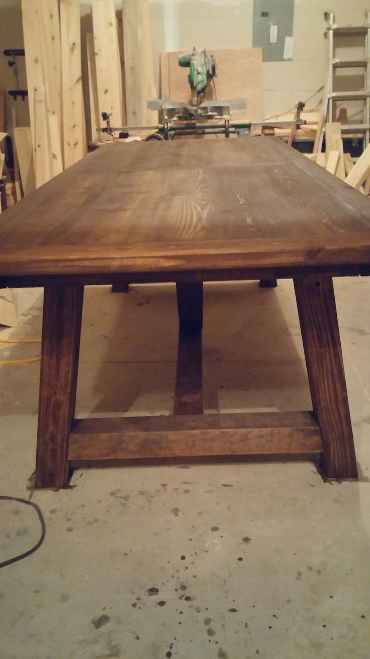 Rustic farm table end view of pottery barn look alike.