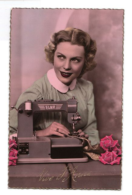 vintage postcard woman with sewing machine