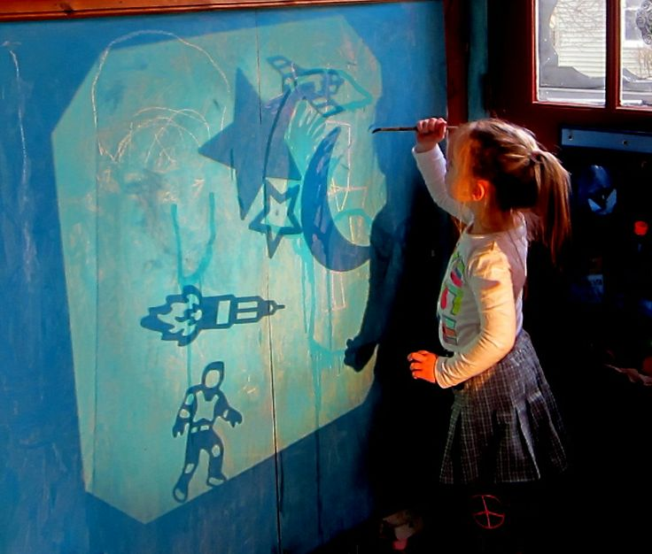 We could use something like this where a child draws over projections onto the boxes to create set