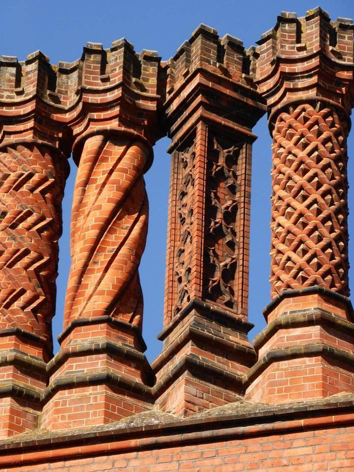 Decorative brick chimney stacks atop Hampton Court Palace. (They're Victorian but follow the original Tudor design.) Photo © The Tudor Tutor