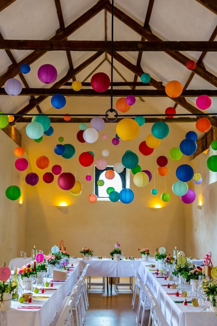 Love these multi-colored paper lanterns hanging above dinner party tables