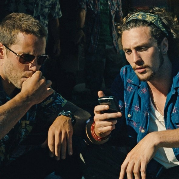 Aaron Johnson and Taylor Kitsch in Savages.. AARON JOHNSON. OH MY GOD. Beauty.