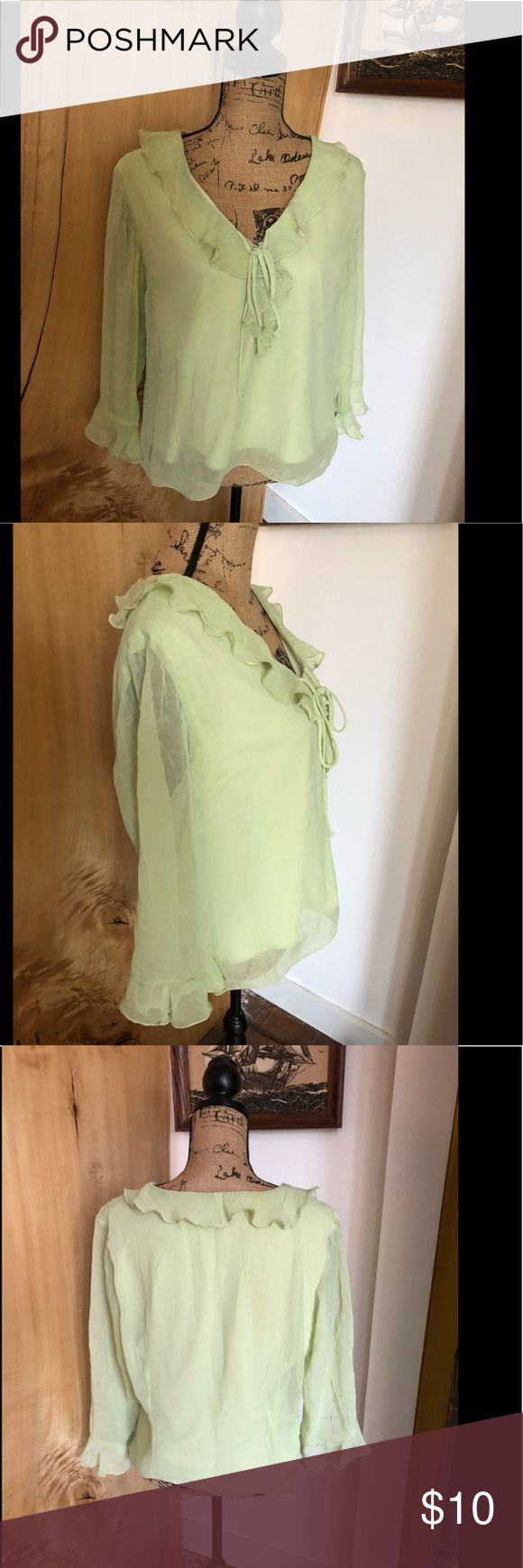 Dress barn light green top Dress barn light green top  This top features a ruffled collar with tie in front sheer sleeves and a wrinkled  effect look with slip underneath  This is a used top and does show signs of wear such as some loose strings COMES FROM A DOG AND SMOKE FRIENDLY HOME Dress Barn Tops Blouses