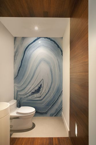 Daily Delight: Agate Wall  From Briana Mowrey in Design Inspiration, Floor & Wall, Inspiring Spaces HGTV blog.  She wanted to achieve this blue agate look, but her fellow Pinterest pinners came to the rescue. Pinner (and interior designer) Lauren Maggio pointed to Alex Turco waterproof art panels, and I think she's spot on. However this bathroom came to be, it's solid! (Solid as a rock.)