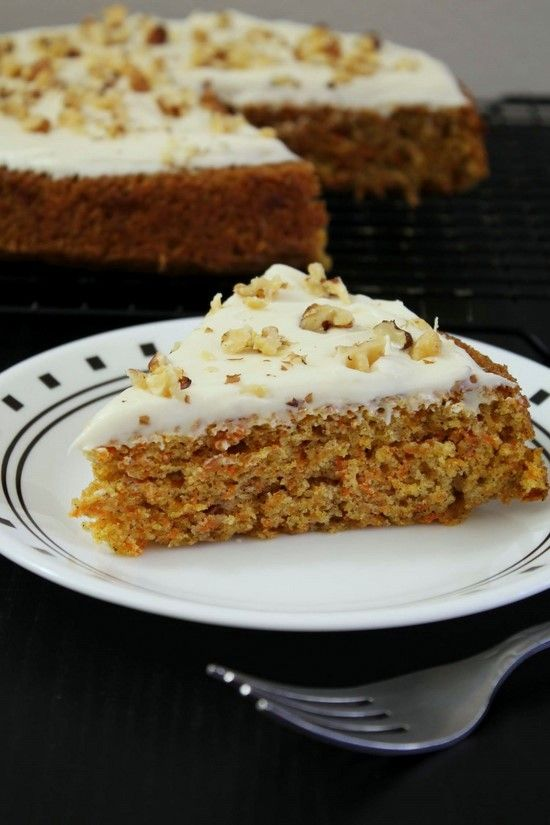Best Eggless carrot cake recipe - soft, moist and delicious cake with cream cheese frosting and topped with walnuts. The flavor of spices in the cake is balanced and perfect.