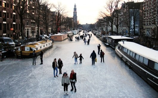 Ice skating on Amsterdam's frozen canals. Who's done this?!