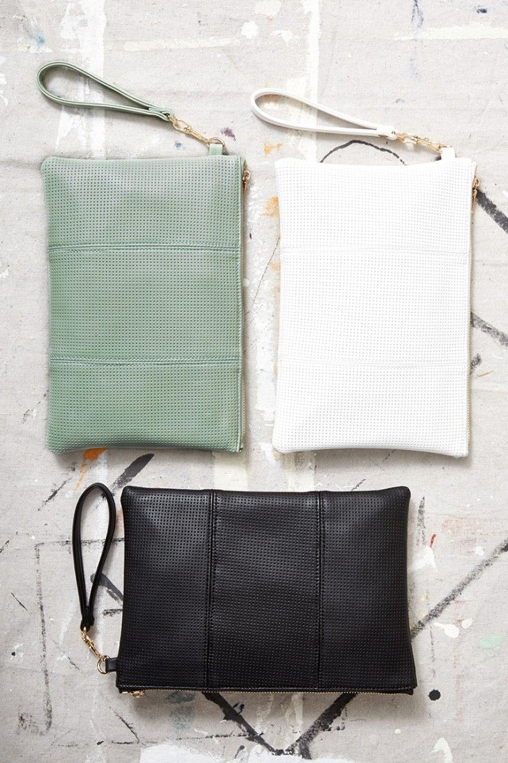 Vegan leather, perforated wristlet clutch in mint, white and black