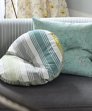 This timeless pale jade colour scheme works beautifully with the smart stripes of Vionna fabric.