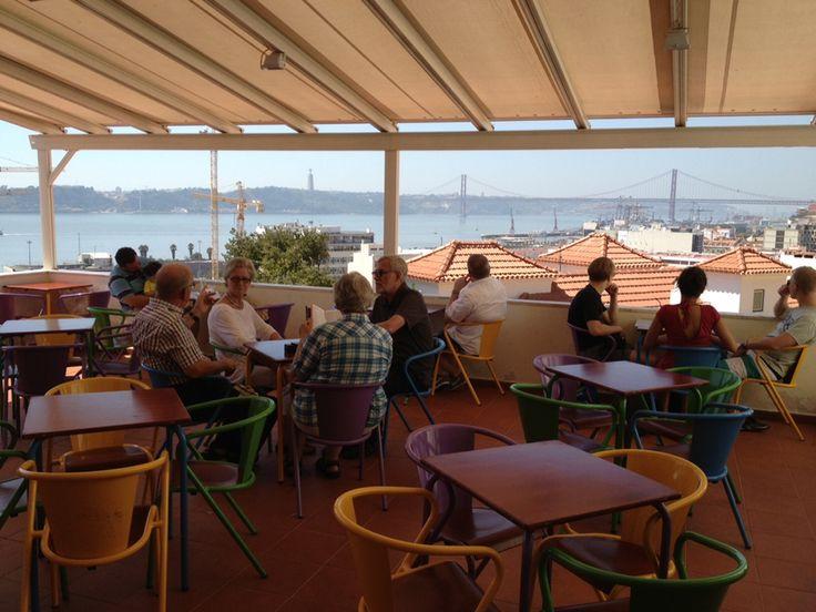 Perched atop one of Lisbon's most striking viewpoints at Miradouro Santa Catarina, in the Chiado is Noobai Café.