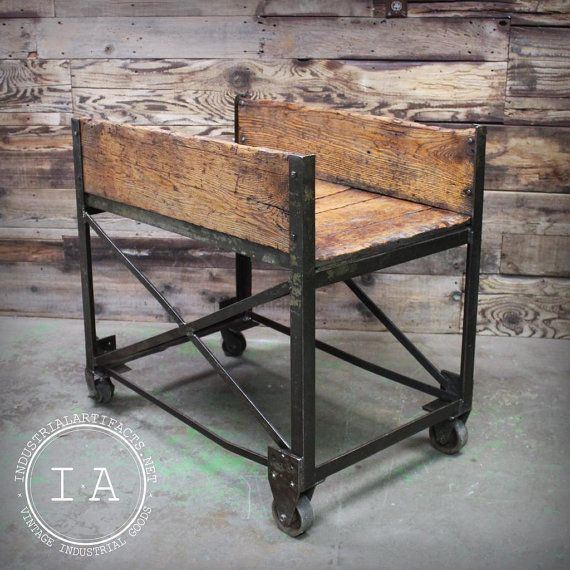 This interesting factory cart came directly out of a facility in Rockford, IL. The industrial design, originally used for moving parts through