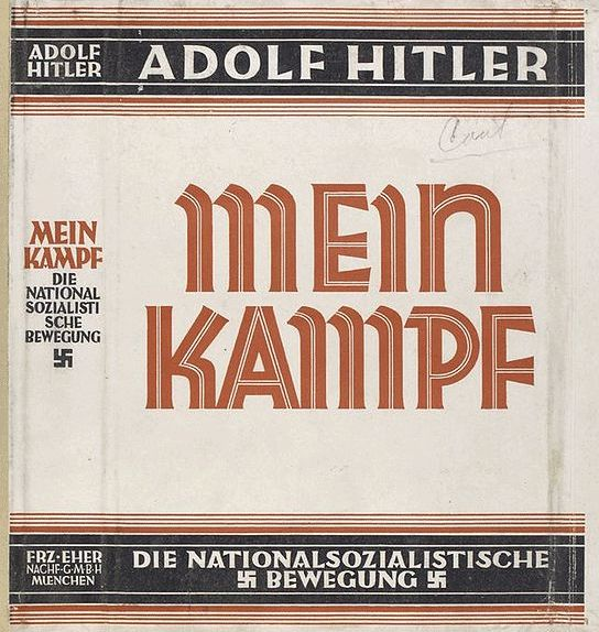"""In 1923, Hitler led his small Nazi party in an attempted seizure of power, ...The (effort) failed and Hitler was sentenced to a lenient jail sentence. It was in jail that he wrote 'Mein Kampf' a rambling exposition of his philosophy which included his growing anti-semitic ideology and ideas of an idealized Aryan race. """"...the personification of the devil as the symbol of all evil assumes the living shape of the Jew. """" – Adolf Hitler, Mein Kampf, Chapter 11.   Jewish Virtual Library"""