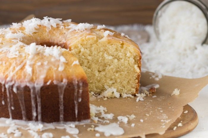 Coconut Pound Cake. Moist, rich pound cake made with shredded coconut and drizzled with coconut glaze.