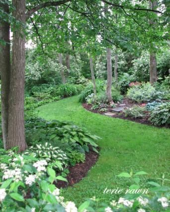 Love this idea of planting more around large trees and having miniature gardens all throughout the grass path.