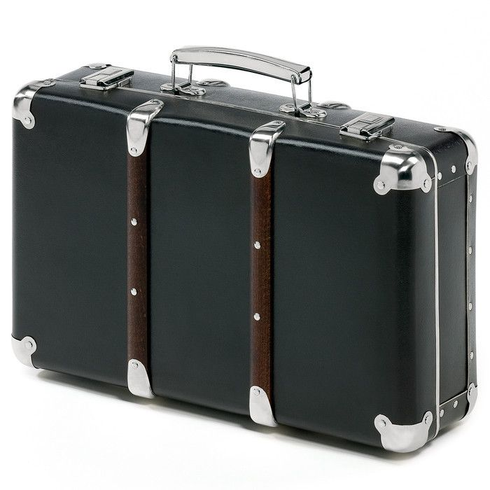 Made from sturdy painted cardboard with metal-reinforced corners and edges, these suitcases look more expensive than they are.