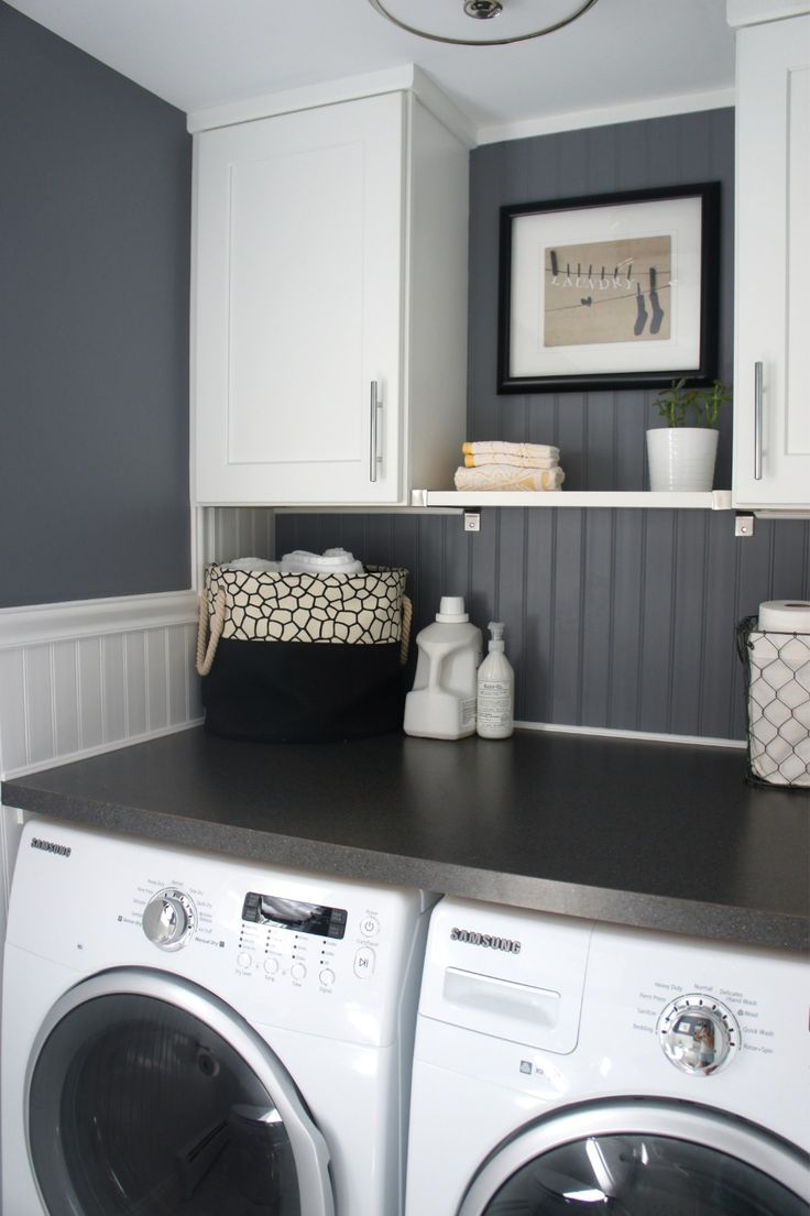 Bead board, grey walls, large tabletop and plenty of storage in laundry room