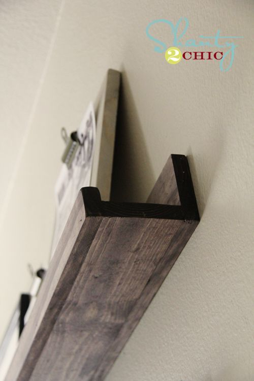 DIY wood shelving. Made 2 of these shelves to hold picture frames in my living room. Love them! Easy to make.
