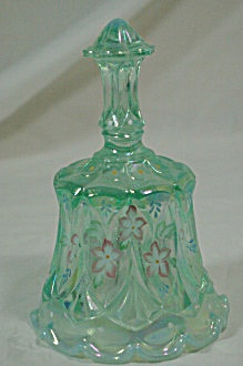 """Circa: 1966  Condition: Used  Size: 6 1/4""""  Color: Green  Type: Bells  Country of Origin: United States  Manufacturer: Fenton    This is a Fenton 6 1/4"""" tall bell. It is a whitton shaped bell in iridescent Opaline green carnival glass with pink and white violets. It is signed by D. Aduson and has the original foil sticker. It is in excellent condition."""
