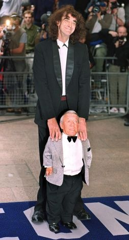 """It may actually surprise some people to know there was a man inside R2's suit. It was  Kenny Baker, shown here with Chewbacca actor Peter Mayhew at the premier of """"Star Wars: Episode 1 -- The Phantom Menace"""" at  London's Leicester square on July 14, 1999. Photo: MIKE SIMMONDS/etty Images, AFP/Getty Images / SL"""
