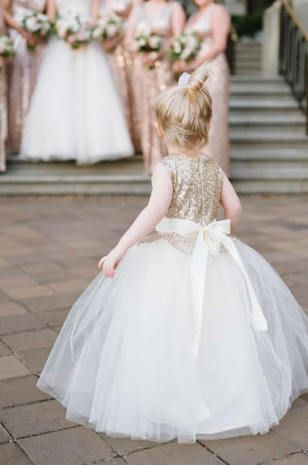 This flower girl's sequin dress is just too cute! {Natalie Frank Photography}