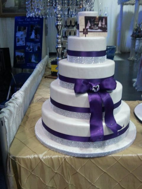 not a huge fan of this exact cake- but it gives you the idea of the white cake with purple ribbon