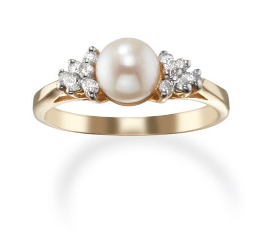This simple 14kt gold ring has a white cultured Pearl center with Diamond clusters.