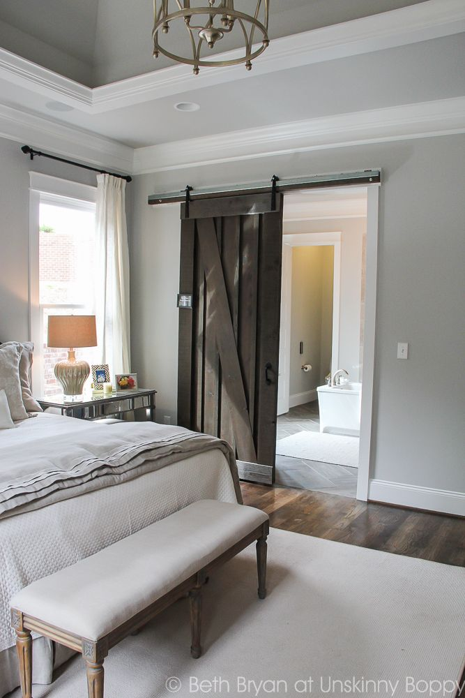 Love the unexpected Sliding Barn door in this beautiful bedroom - Birmingham Parade of Homes Decor Ideas