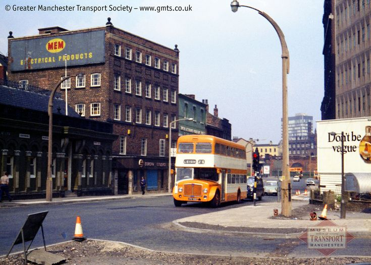 Leigh Corporation Transport was one of the municipal fleets taken over by SELNEC in 1969 and its smart blue buses were repainted orange. Leigh's longest route was a jointly-operated service to Manchester - actually Greengate in Salford, under Manchester Exchange station. 6929 here, formerly Leigh's 29, has just set off on the long journey back to its home town and Victoria bus station can just be seen in the background. If you'd like to know more about the Manchester Museum of Tr...