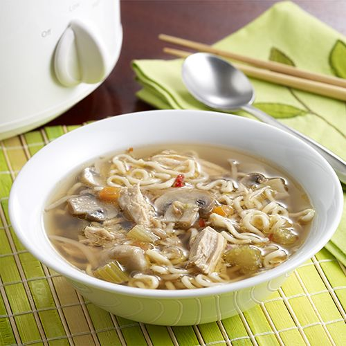An Asian soup recipe with pork, ramen noodles, vegetables, soy sauce and ginger for an easy main dish