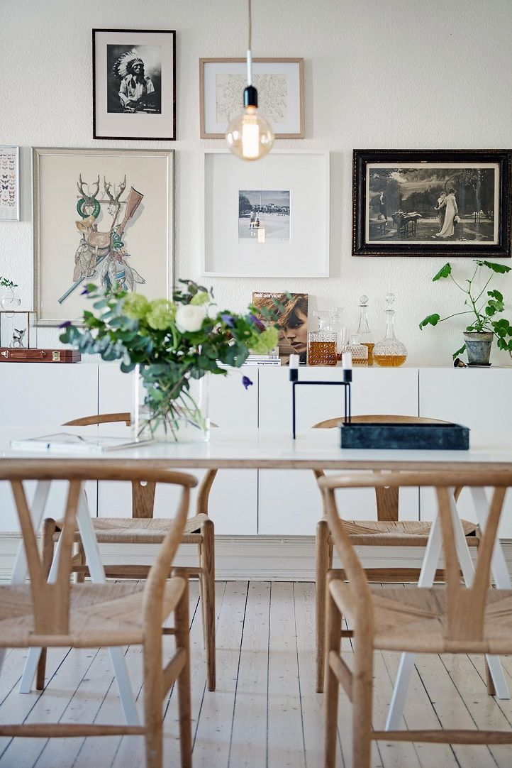 Dining table and sideboard styling: gallery wall, green plants, flowers, simplicity, personal objects. Love it!