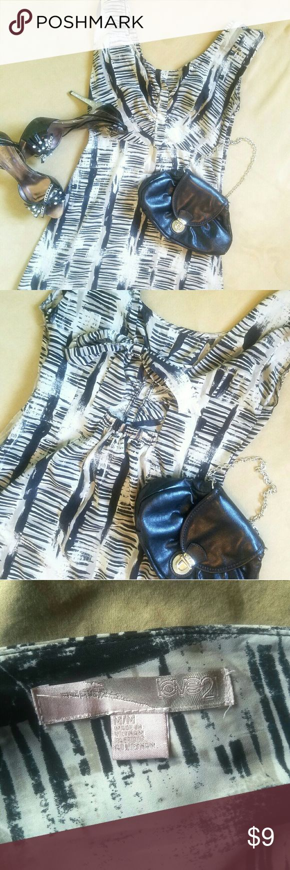 Casual and Cute Summer dress Black and white patterned mini dress with open back and tie. Super cute find and flirty. Wear with heels or thrown on some strappy sandals for a casual look. Size M by Love 21 Forever 21 Dresses Mini