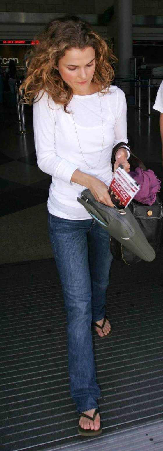 I like how she carries her scarf--great color--on her bag.