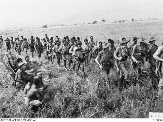 NEW GUINEA. 8 NOVEMBER 1943. A PAPUAN INFANTRY BATTALION PATROL LED BY AUSTRALIAN SOLDIERS SETS OUT INTO THE MOUNTAINS FROM KUMBARUM, BELOW SHAGGY RIDGE. THE AUSTRALIANS LEADING THE PATROL, FROM ...