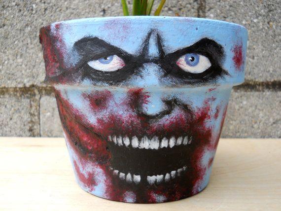 Zombie Walking Dead style painted flower pot. via Etsy.