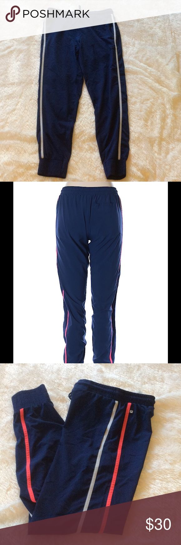 Fabletics cuffed joggers These are so cute! Lightweight navy joggers with thin pink and white stripes down the legs. Slim fit and cuffed ankles make for a great silhouette. Worn once. Size xs (I wish I could keep them but they're just a tiny bit too small for me). Fabletics Pants Track Pants & Joggers