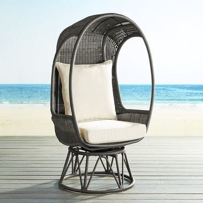 "Once again, we've used the model of our iconic Papasan to develop a chair that's as fun as it is comfortable: The Spinasan™. Constructed of hand-woven, all-weather wicker over a rust-resistant, powder-coated metal frame, our egg-shaped chair is attached to a swivel base for all-around merriment—indoors or out. <span id=""mini-upsell"" data-launch=""true"" data-required=""false"" data-product=""Cushions"" data-masters=""PV..."