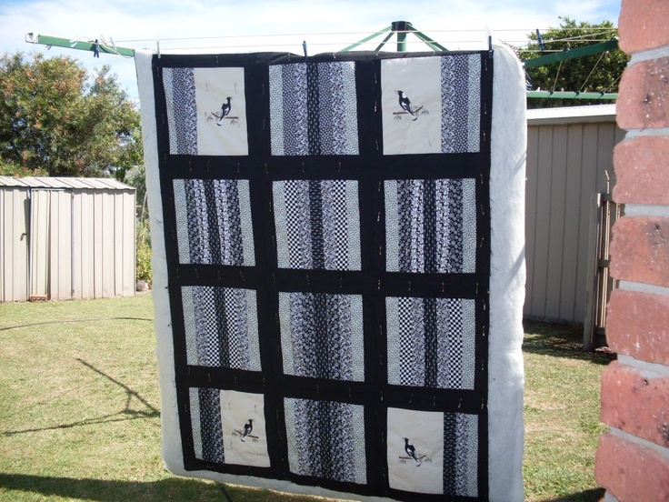 Afl collingwood quilt (magpies) for grandson  on my janome embroidery 350e  machine