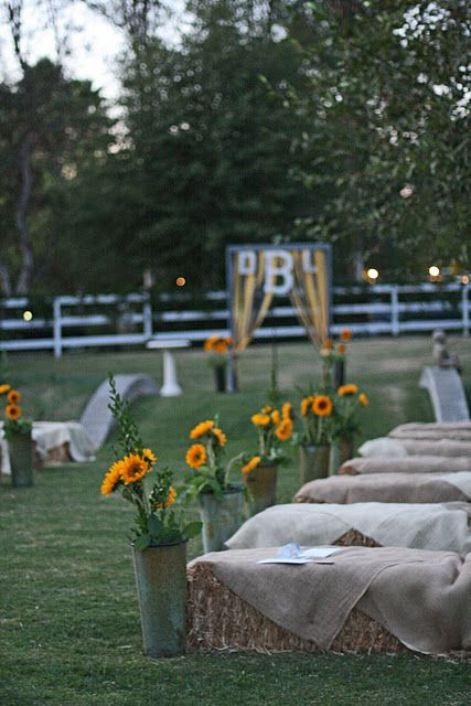 Country wedding all the way! Hay bales and burlap! (: cute