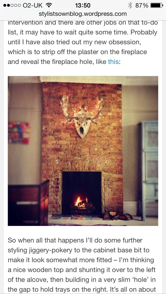 Exposed brick fireplace, coving & grey walls