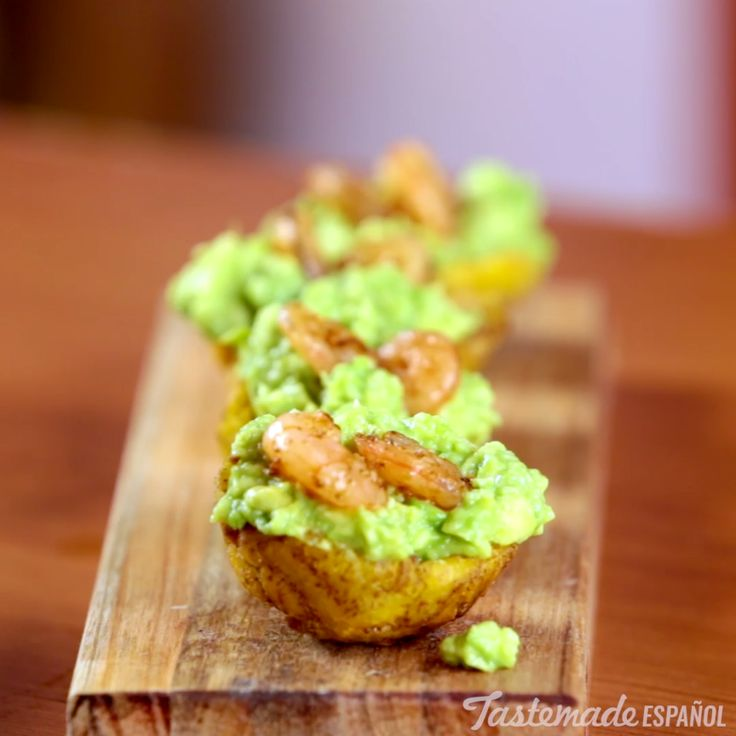 Twice-fried plantains topped with avocado and seasoned shrimp is the perfect savory finger food.