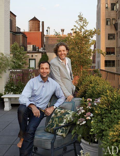 HBO executive James Costos (left) and designer Michael S. Smith on the terrace of their Manhattan penthouse.