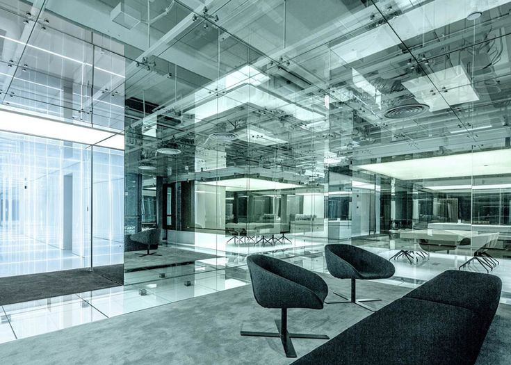 Shanghai studio AIM Architecture designed the office for Soho China, the property developers behind Zaha Hadid's Galaxy Soho and Wangjing Soho projects, and it occupies a space in the company's Fuxing Plaza complex.