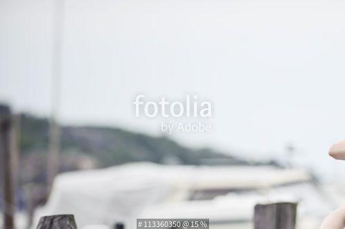 """Sisters sitting by the water"" Стоковая фотография и роялти-фри изображение на Fotolia.ru - Pic 113360350"