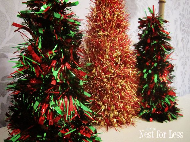 tinsel trees, cardboard cones, hot glue starting at top of cone! @ howtonestforless.com